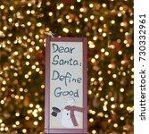 Small photo of Dear Santa, define good sign