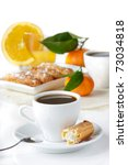 Cup of black coffee, eclairs, juice and fruit. - stock photo