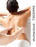 woman receiving back massage... | Shutterstock . vector #73034944