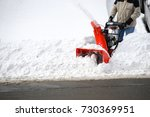 man operating snow blower to... | Shutterstock . vector #730369951
