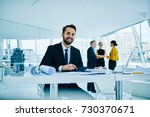 portrait of cheerful financial... | Shutterstock . vector #730370671