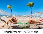beach relaxation sun tanning... | Shutterstock . vector #730374505