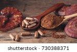 ganoderma lucidum capsule on... | Shutterstock . vector #730388371