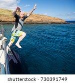bald man jumping into the ocean | Shutterstock . vector #730391749