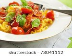 pasta with tuna fish and tomato | Shutterstock . vector #73041112