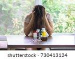 depressed woman sitting head in ... | Shutterstock . vector #730413124