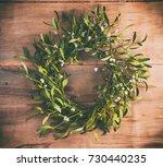 christmas wreath from mistletoe ...   Shutterstock . vector #730440235