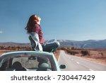 hipster girl relaxing on the... | Shutterstock . vector #730447429