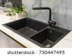 black kitchen sink and tap... | Shutterstock . vector #730447495