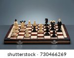chess board and chess pieces.... | Shutterstock . vector #730466269