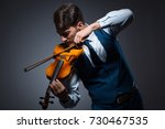 Young Man Playing Violin In...