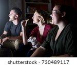 happy friends watching tv with... | Shutterstock . vector #730489117