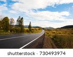 road to the mountains in autumn | Shutterstock . vector #730493974
