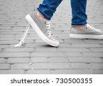foot stuck into chewing gum on... | Shutterstock . vector #730500355