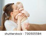 mother kisses her child in...   Shutterstock . vector #730505584