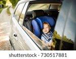 little boy sitting in the car... | Shutterstock . vector #730517881