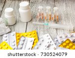 lot of medicines  syringe ... | Shutterstock . vector #730524079