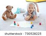 cute little girl painting... | Shutterstock . vector #730528225