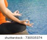 closeup woman training yoga and ... | Shutterstock . vector #730535374