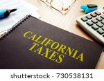 book with california taxes on a ... | Shutterstock . vector #730538131
