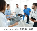 medical staff discussing x ray...   Shutterstock . vector #730541401
