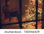 man at christmas home  | Shutterstock . vector #730546429