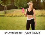 sporty young woman with protein ... | Shutterstock . vector #730548325
