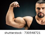 selective focus of strong man... | Shutterstock . vector #730548721