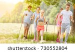 group in summer nordic walking... | Shutterstock . vector #730552804