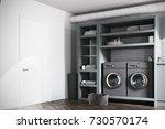 modern laundry room interior... | Shutterstock . vector #730570174