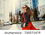 fashion outdoor portrait of... | Shutterstock . vector #730571479