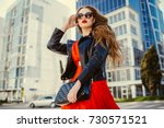 fashion outdoor portrait of... | Shutterstock . vector #730571521