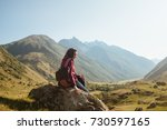 a young woman traveler with... | Shutterstock . vector #730597165