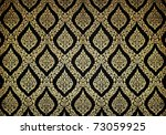 Thai floral pattern design on wall - stock photo