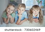 two blonde girls and blond boy... | Shutterstock . vector #730602469