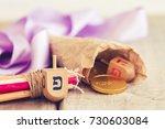 hanukkah dreidels with some... | Shutterstock . vector #730603084