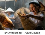 old vietnamese female craftsman ... | Shutterstock . vector #730605385