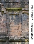 Small photo of Wall of stone castle made of laterite in Thailand.