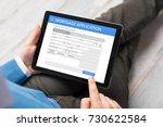 man filling mortgage... | Shutterstock . vector #730622584