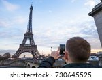 tourist enjoy view on eiffel... | Shutterstock . vector #730645525