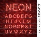 realistic neon alphabet. bright ... | Shutterstock .eps vector #730654327