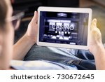 man playing in an online casino ... | Shutterstock . vector #730672645
