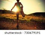 trail runner woman stretching... | Shutterstock . vector #730679191