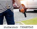 man carrying a pistol is a... | Shutterstock . vector #730689565