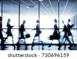 moving silhouettes of... | Shutterstock . vector #730696159
