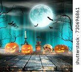 Small photo of Spooky Halloween pumpkins on wooden planks with spooky background.