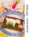 funny easter breakfast with lamb shape on sandwich for child - stock photo