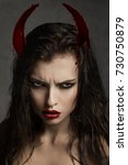 brunette model with devil horns  | Shutterstock . vector #730750879