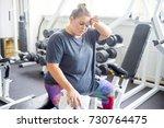 fat girl in a gym | Shutterstock . vector #730764475
