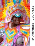 Small photo of NASSAU, THE BAHAMAS - JANUARY 1 - Smiling, dancing woman in pink and orange costume, performs in Junkanoo, a traditional island cultural festival in Nassau, Jan 1, 2011